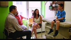 Office visit: Pediatrician Dr. Thomas Ciecierega with Alex and his family.